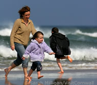 Family on beach photo by Sarah Milligan/Visit Cornwall