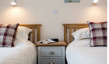 Double and twin bedroom at Penpont Mill holiday cottage