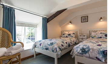 Twin bedroom at The Retreat holiday cottage